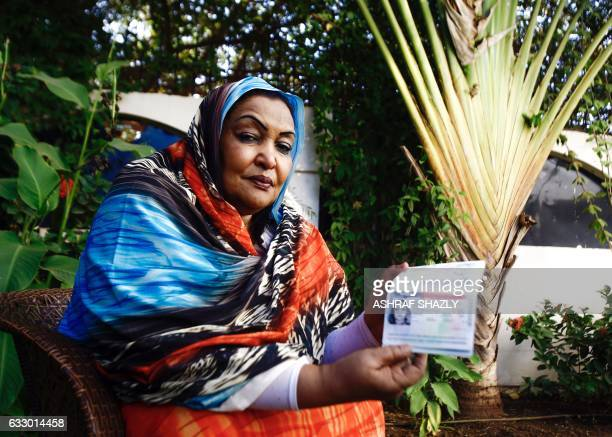 Sudanese citizen Fatima Abul Qasim Gash shows her US visa in her passport during an interview with AFP in Khartoum on January 29 2017 after she was...
