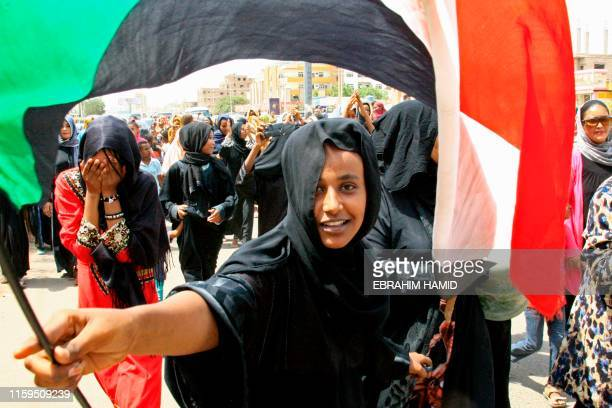 Sudanese demonstrater waves her national flag as people celebrate in Khartoum on August 4, Sudan's army rulers and protest leaders a hard-won...