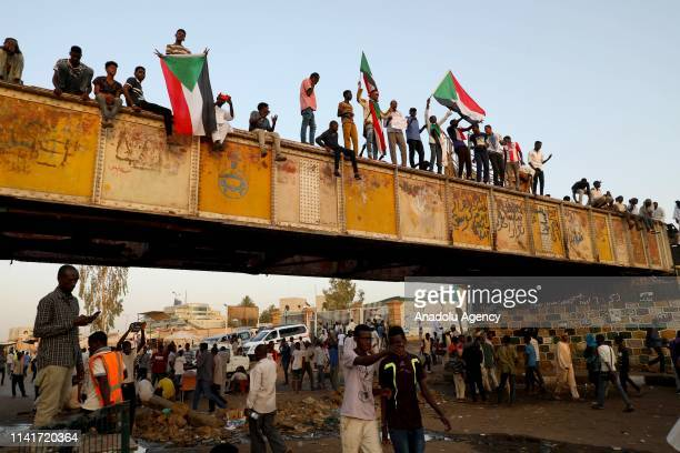 Sudanese demonstrators attend the ongoing protests demanding a civilian transition government in front of military headquarters, on the first day of...