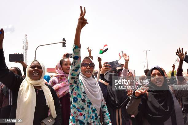 TOPSHOT Sudanese demonstrators chant slogans as they gather in a street in central Khartoum on April 11 immediatly after one of Africa's...