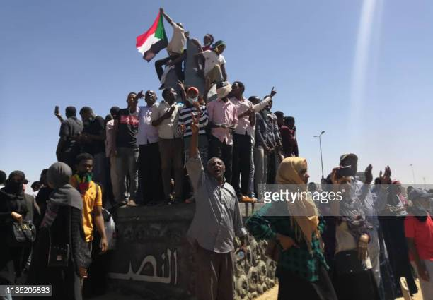 Sudanese demonstrators chant slogans outside the army headquarters in the capital Khartoum on April 6, 2019. - Protests have rocked the east African...