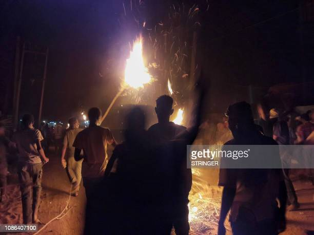 Sudanese demonstrators gather during an antigovernment protest in the Haj Yousef neighbourhood of the Bahari district in the capital Khartoum on...