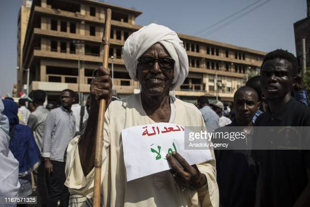 Sudanese demonstrators gather for a demonstration demanding an attorney general and head of judiciary be appointed at Qasr Street of Khartoum in...