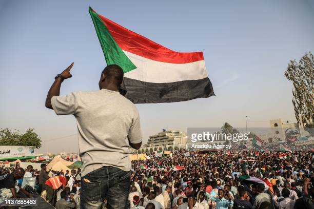 Sudanese demonstrators gather in front of military headquarters during 13th days of continuing demonstrations demanding a civilian transition...