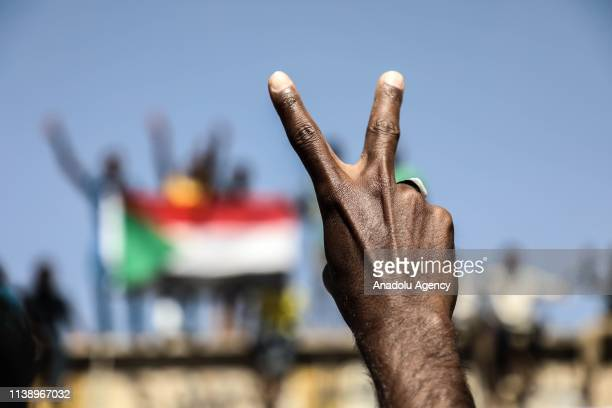 Sudanese demonstrators gather in front of military headquarters during a demonstration demanding a civilian transition government, in Khartoum, Sudan...
