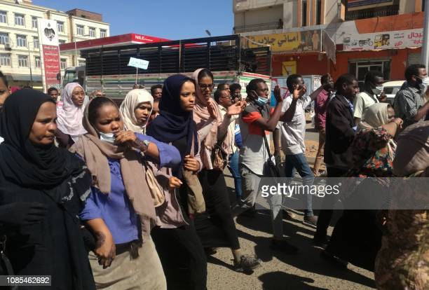 Sudanese demonstrators gather in Khartoum's twin city Omdurman on January 20 where Sudanese police fired tear gas at protesters ahead of a planned...