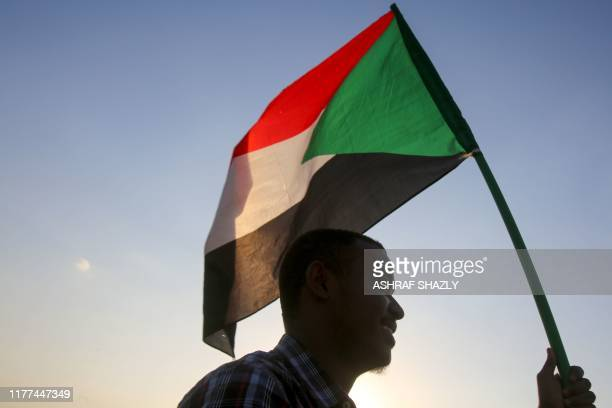 Sudanese demonstrators march during a protest in the capital Khartoum on October 21 2019 Thousands of Sudanese rallied in several cities including...