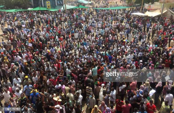 TOPSHOT Sudanese demonstrators rally in front of the military headquarters in the capital Khartoum on April 10 2019 Thousands of protesters have been...