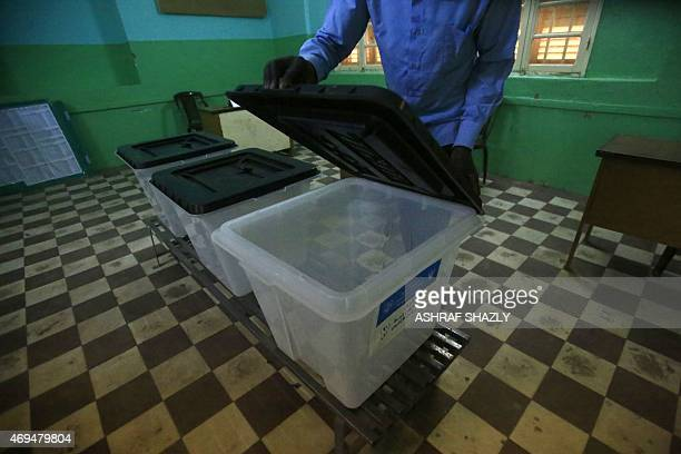 A Sudanese election official prepares ballot boxes at the Saint Francis school turned into a polling station in the capital Khartoum on April 12 on...