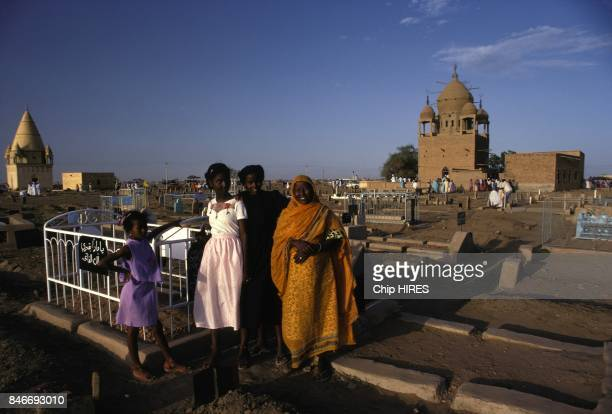 A sudanese family in a cemetary of Omdurman the largest city in Sudan and Khartoum State on February 24 1983 in Sudan