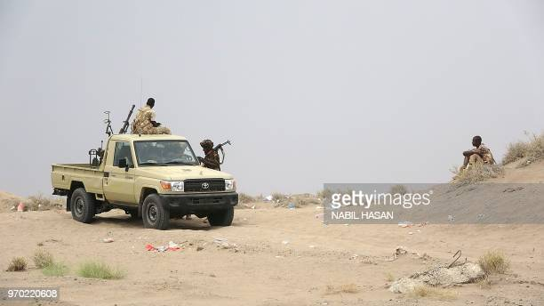 Sudanese fighters battling alongside Yemen's Saudibacked progovernment forces against Huthi rebels gather on June 7 near the city of Al Jah in the...