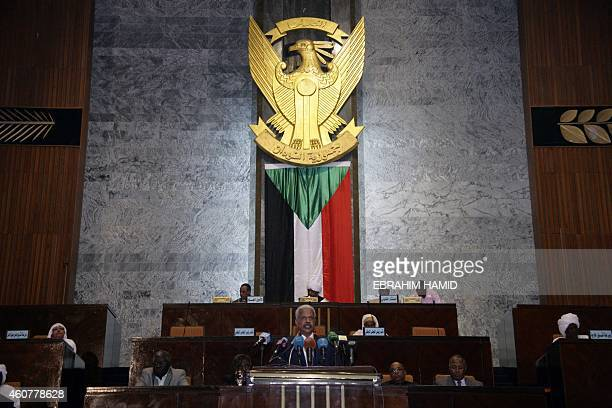Sudanese Finance Minister Badereldien Mahmoud presents budget figures at parliament in Khartoum on December 22 2014 Sudan's electoral body said on...