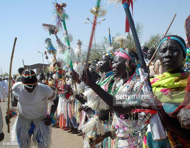 Sudanese folkloric troupe perform a traditional dance during celebrations at the headquarters of the ruling National Congress party in Khartoum 01...