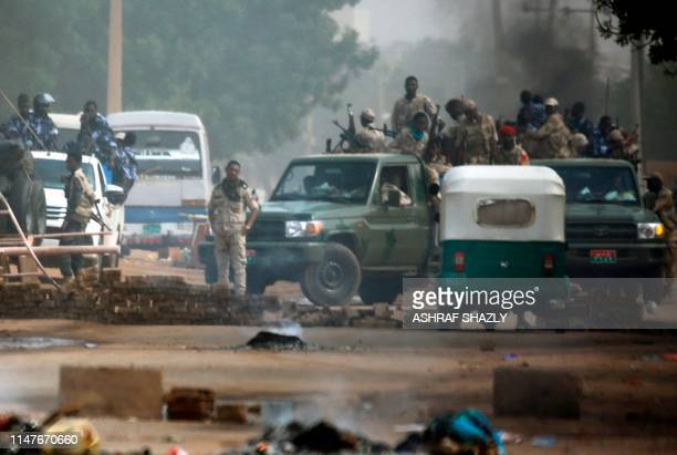 Sudanese forces are deployed around Khartoum's army headquarters on June 3, 2019 as they try to disperse Khartoum's sit-in. - At least two people...