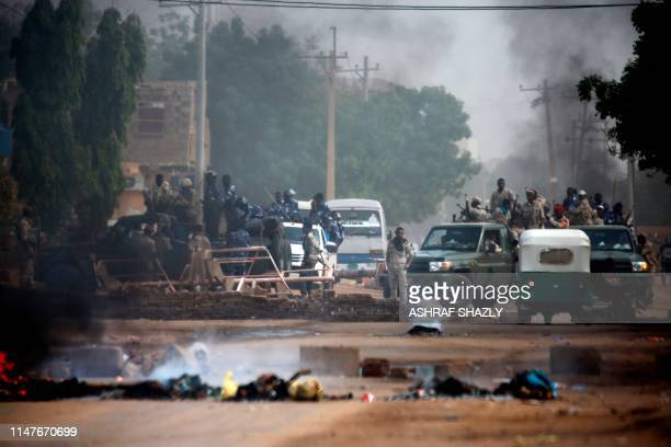 TOPSHOT Sudanese forces are deployed around Khartoum's army headquarters on June 3 2019 as they try to disperse Khartoum's sitin At least two people...