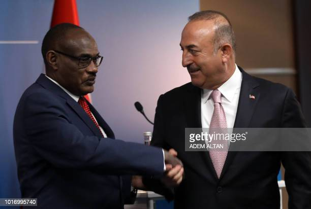 Sudanese Foreign Minister ElDirdeiry Mohamed Ahmed and Minister of Foreign Affairs of Turkey Mevlut Cavusoglu shake hands as they hold a joint press...