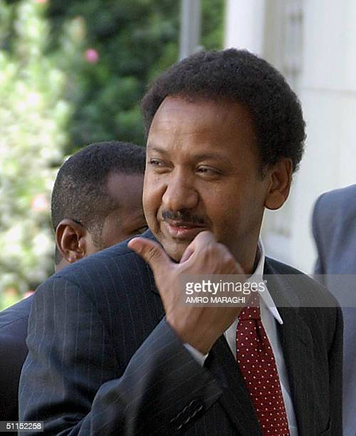 Sudanese Foreign Minister Mustafa Ismail thumbs as he arrives at the Arab League to attend an emergency meeting of Arab foreign ministers for the...