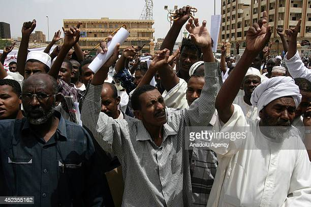 Sudanese gather to stage a protest against the ongoing Israeli attacks on Gaza July 18 2014 in the capital Khartoum Sudan