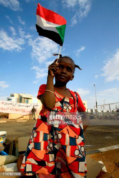 A Sudanese girl waves her national flag in Khartoum on June 2 2019 The military ousted president Omar alBashir in April after months of protests...