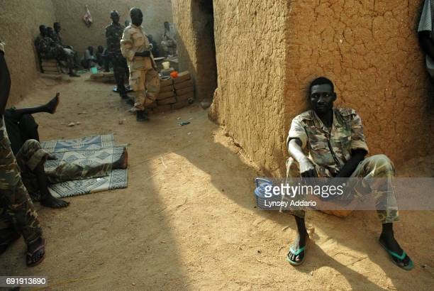 Sudanese government soldiers sit in a prison in Iriba in northeastern Chad October 14 2006 Fierce fighting continues between Sudanese government...