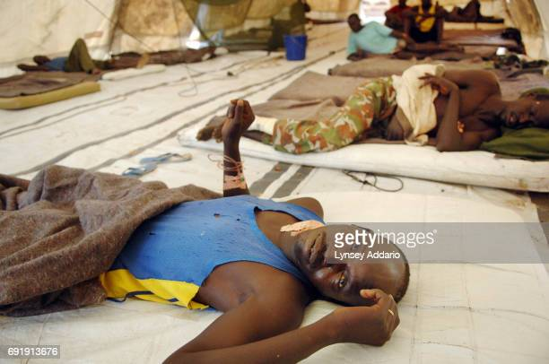 Sudanese government soldiers sit wounded in a local hospital in Iriba in northeastern Chad October 14 2006 Fierce fighting continues between Sudanese...