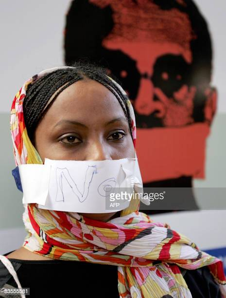 A Sudanese journalist covers her mouth with a paper bearing the writing 'NO' during a mass hunger strike held by Sudanese journalists in the capital...
