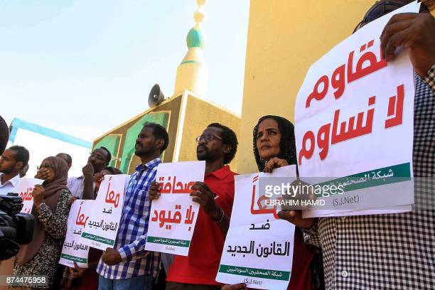 Sudanese journalists protest against a proposed new press law that aims to tighten restrictions on media freedom at the headquarters of the National...