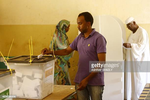 A Sudanese man casts his vote at a school turned into a polling station on April 14 2015 in AlJarif West outside Khartoum on the second day of a...