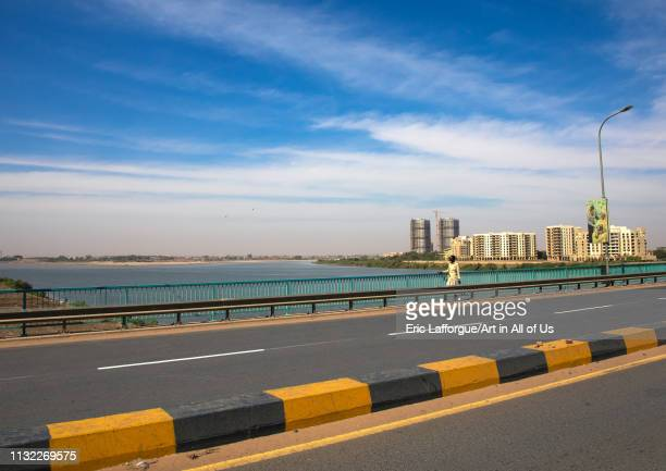 Sudanese man crossing a bridge over river Nile, Khartoum State, Khartoum, Sudan on January 4, 2019 in Khartoum, Sudan.