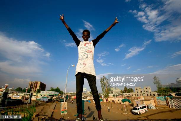 Sudanese man flashes the v for victory sign in Khartoum on June 2 2019 The military ousted president Omar alBashir in April after months of protests...