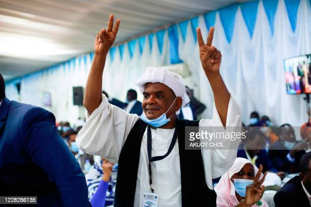 A Sudanese man gestures the peace sign during the singing of the Sudan peace deal with the rebel in Juba South Sudan on August 31 2020 Sudanese...