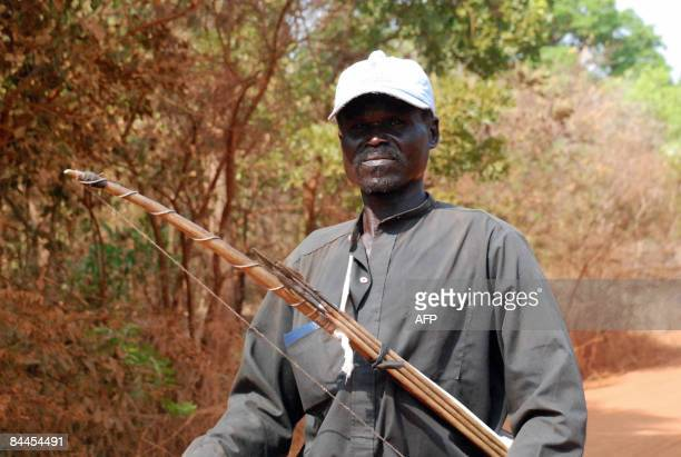 Sudanese man patrols with a bow and arrows an area in the southern Sudanese state of Western Equatoria following a series of attacks by the rebel...