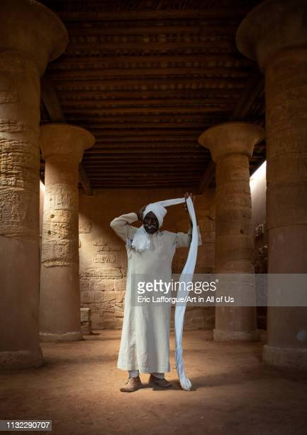 Sudanese man putting his turban in the Musawwarat essufra meroitic lion temple Nubia Musawwarat esSufra Sudan on December 29 2018 in Musawwarat...