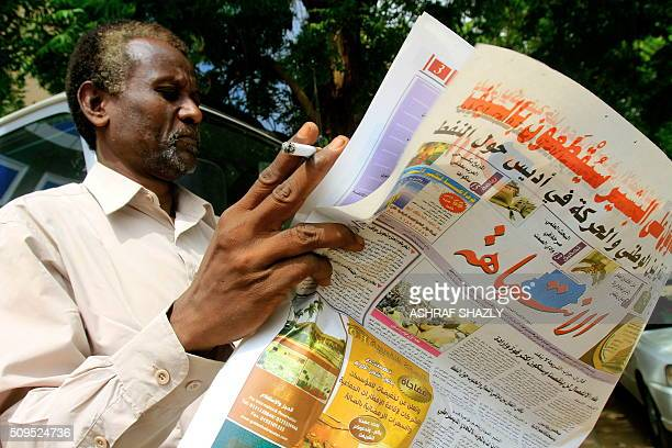 Sudanese man reads a newspaper as he smokes a cigarette in the capital Khartoum, on July 31 as fears of tighter press freedom in the wake of South...