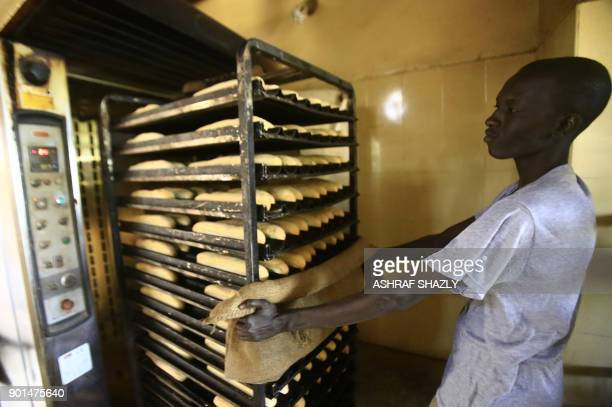 A Sudanese man works at a bakery in the capital Khartoum on January 5 2018 Angry Sudanese queued outside bakeries in Khartoum as bread prices doubled...