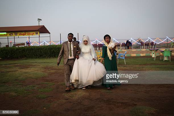 Sudanese married couple are seen beside Nile street in Khartoum Sudan on April 9 2016