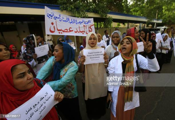 Sudanese medics shout slogans as they hold a rally in front of a hospital in the capital Khartoum on May 23 2019 Sudan's protest leaders said today...