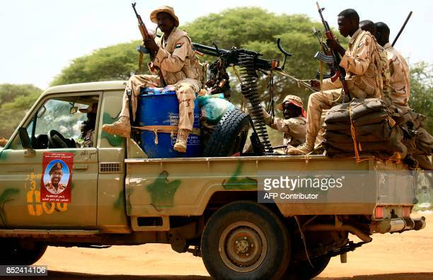 Sudanese members of the Rapid Support Forces a paramilitary force backed by the Sudanese government to fight rebels and guard the SudanLibya border...