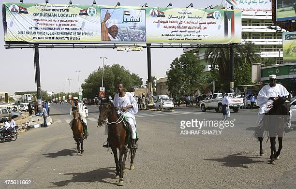 A Sudanese men celebrate in the streets following President Omar alBashir's swearing in ceremony for another term of five years at the parliament in...