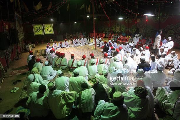 Sudanese men gather for prayer on the eve of the birth anniversary of Islam's Prophet Mohammed in the capital Khartoum on January 12 2014 Prophet...