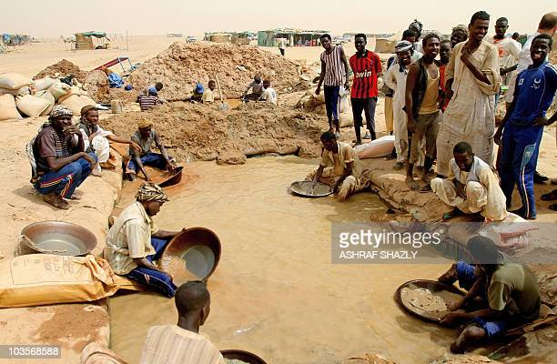 Sudanese men pan for gold at the village of alAbidiya in northern Sudan on August 9 2010 Rising gold prices combined with the availability of metal...