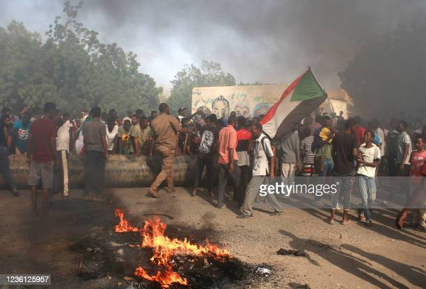 Sudanese man protest against a military coup that overthrew the transition to civilian rule, on October 25, 2021 in the al-Shajara district in...