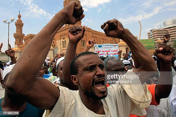 Sudanese men shout slogans during a protest against an amateur film mocking Islam following Friday prayers outside the Grand Mosque in Khartoum on...