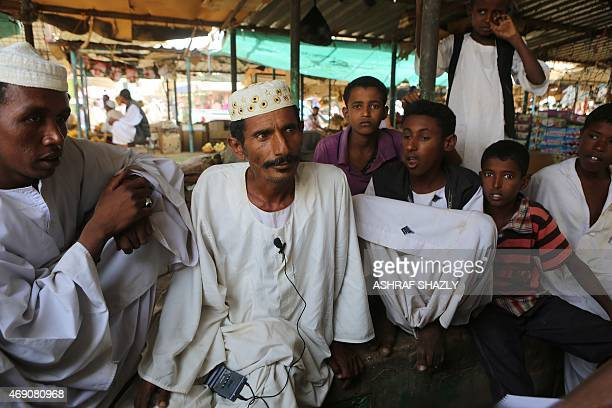 Sudanese men sit at a market in Shendi the hometown of Sudanese President Omar alBashir located on the banks of the Nile in Sudan's Arab heartland...