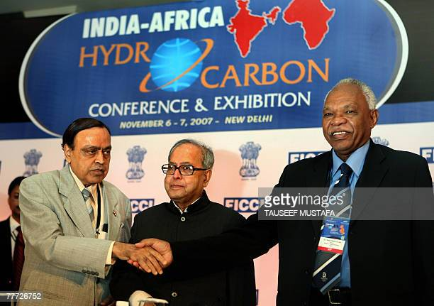 Sudanese Minister of Energy Awad Ahmed AlJaz shake hands with Indian Union minister for Petroleum and Natural Gas Murli Deora as Indian Minister for...