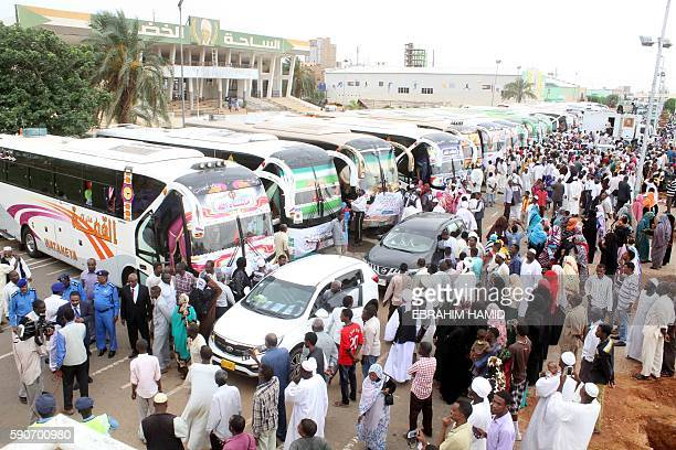 Sudanese Muslim pilgrims gather next to coaches before leaving for the annual Hajj pilgrimage to the Holy city of Mecca on August 17 2016 in the...