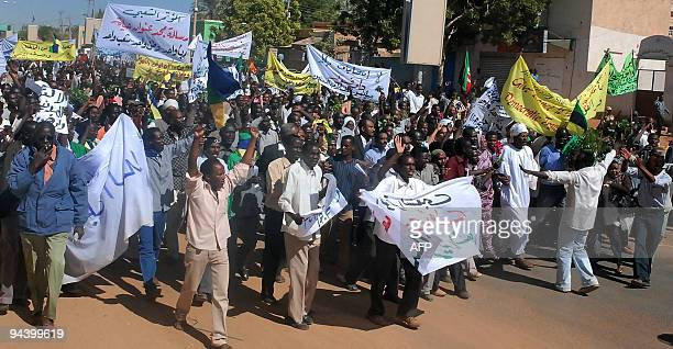 Sudanese opposition supporters take part in a prodemocracy rally in Khartoum's twin city of Omdurman on December 14 2009 Sudanese police fired tear...