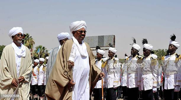 Sudanese Parliament speaker Ahmed Ibrahim alTahir walks behind Sudanese President Omar alBashir past the honor guard to the parliament building in...