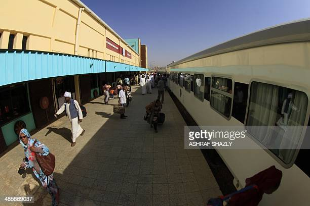Sudanese passengers stand at a platform of the new Nile Train in Khartoum on March 17 2014 In a dilapidated povertystricken country where some...