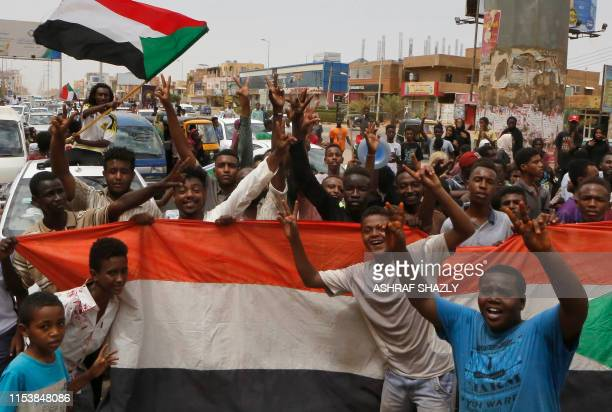 Sudanese people celebrate in the streets of Khartoum after ruling generals and protest leaders announced they have reached an agreement on the...